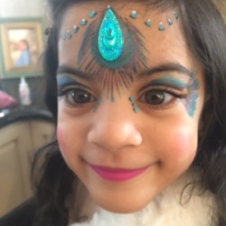Peacock feathers face painting
